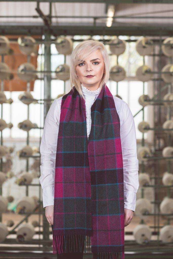Woman wearing Foxford's Wicklow Tartan Dark Scarf in Woollen Mill