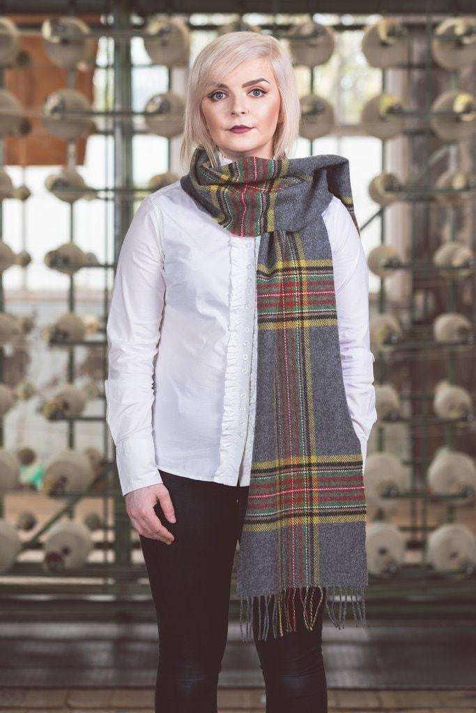 Woman wearing Foxford's Classic Mirror Block Check Scarf in Woollen Mill