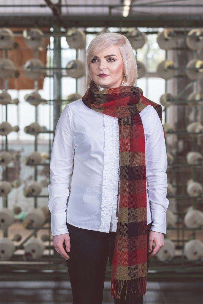 Woman wearing Foxford's Country Block Check Scarf in Woollen Mill