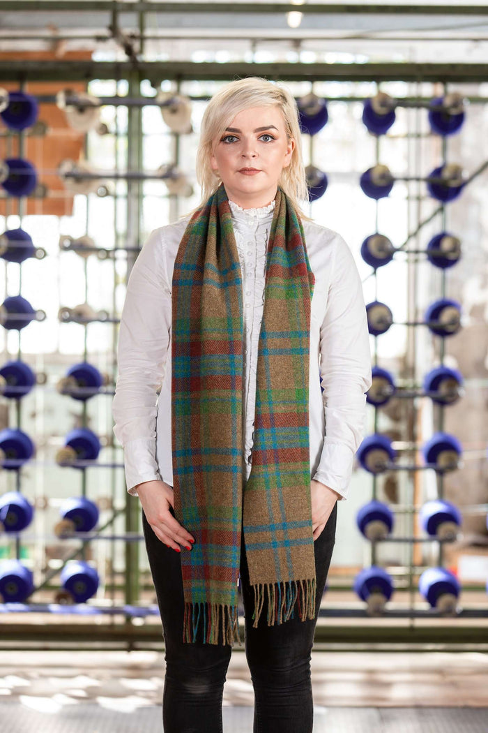 Woman wearing Foxford's Traditional Large Check Scarf in Woollen Mill