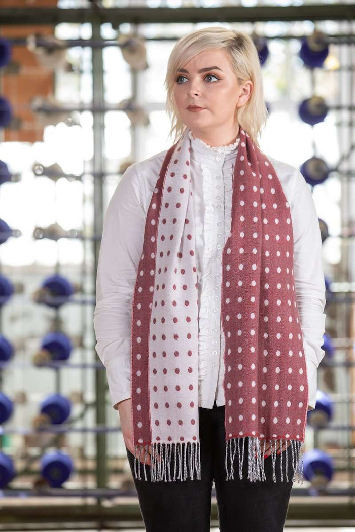Woman wearing Foxford's Tomato, Grey & White Extra Fine Merino Scarf in Woollen Mill