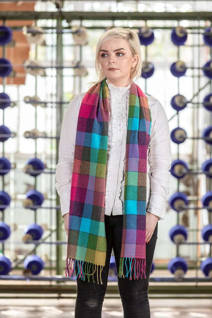 Woman standing in Mill wearing Foxford's Check Shannon Scarf