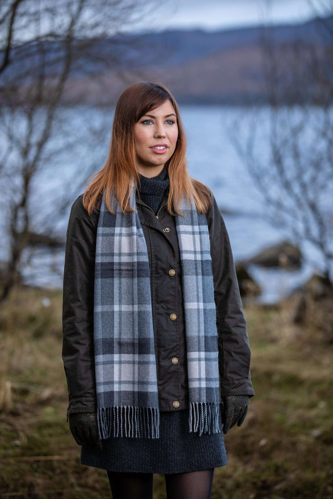 Woman wearing Foxford's Classic Mirror Block Check Scarf in Irish Countryside