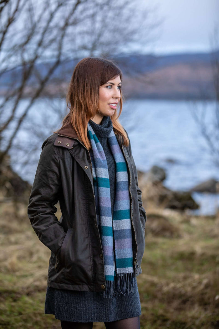 Woman wearing Foxford's Purple Colour Stripe Scarf in the Irish Countryside