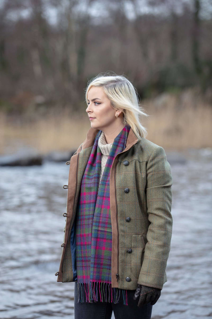 Woman wearing Foxford's Purple Broken Check Scarf beside the River Moy