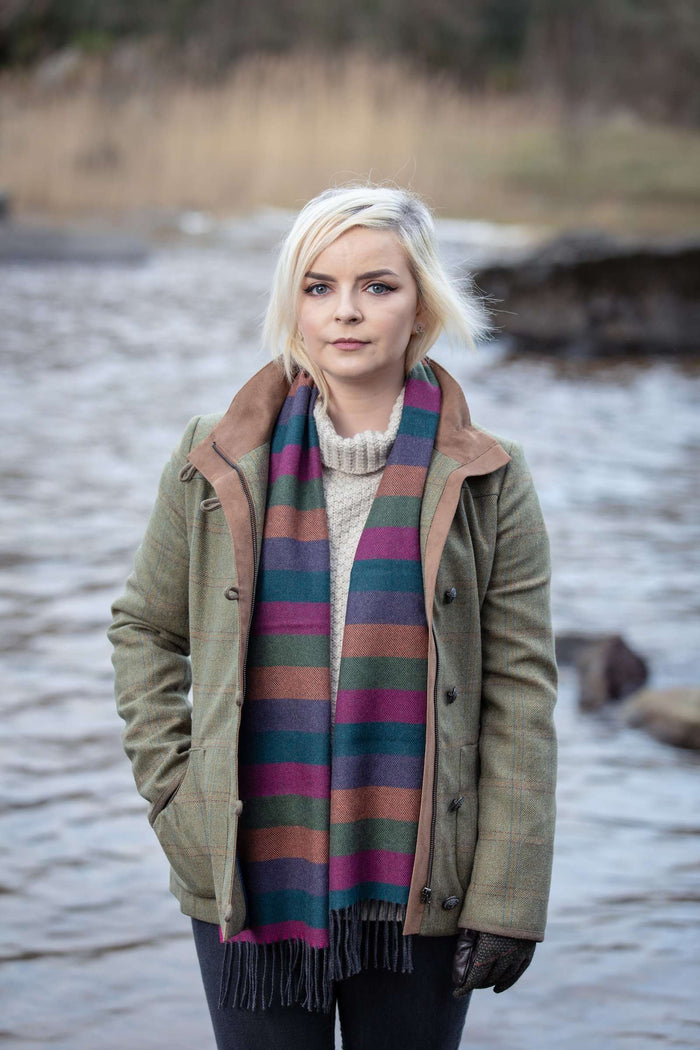 Woman wearing Foxfrod's Multi Colour Stripe Scarf beside River Moy