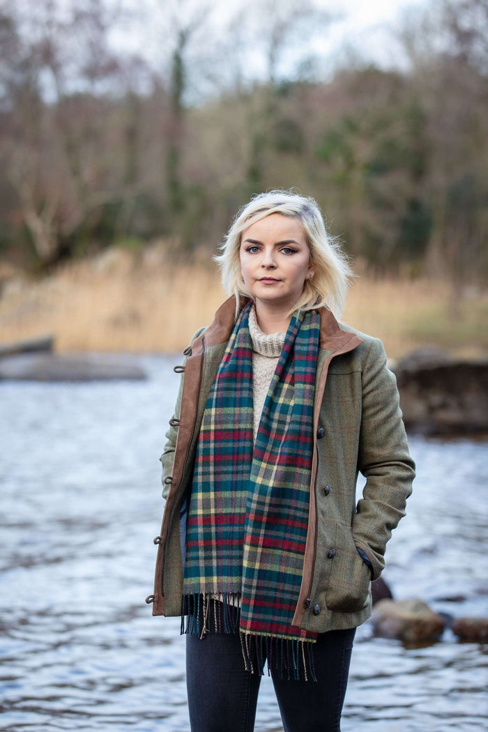 Woman wearing Foxford's Heritage Broken Check Scarf by the River Moy