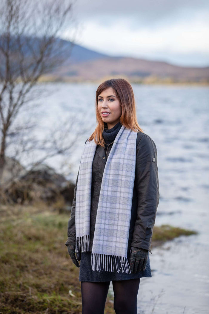 Woman wearing Foxford's Mink and Pink Glen Check Scarf in the Irish Countryside