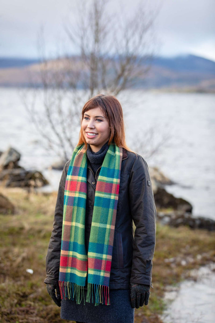 Woman wearing Foxford's Leaf Mirror Block Check Scarf in the Irish Countryside