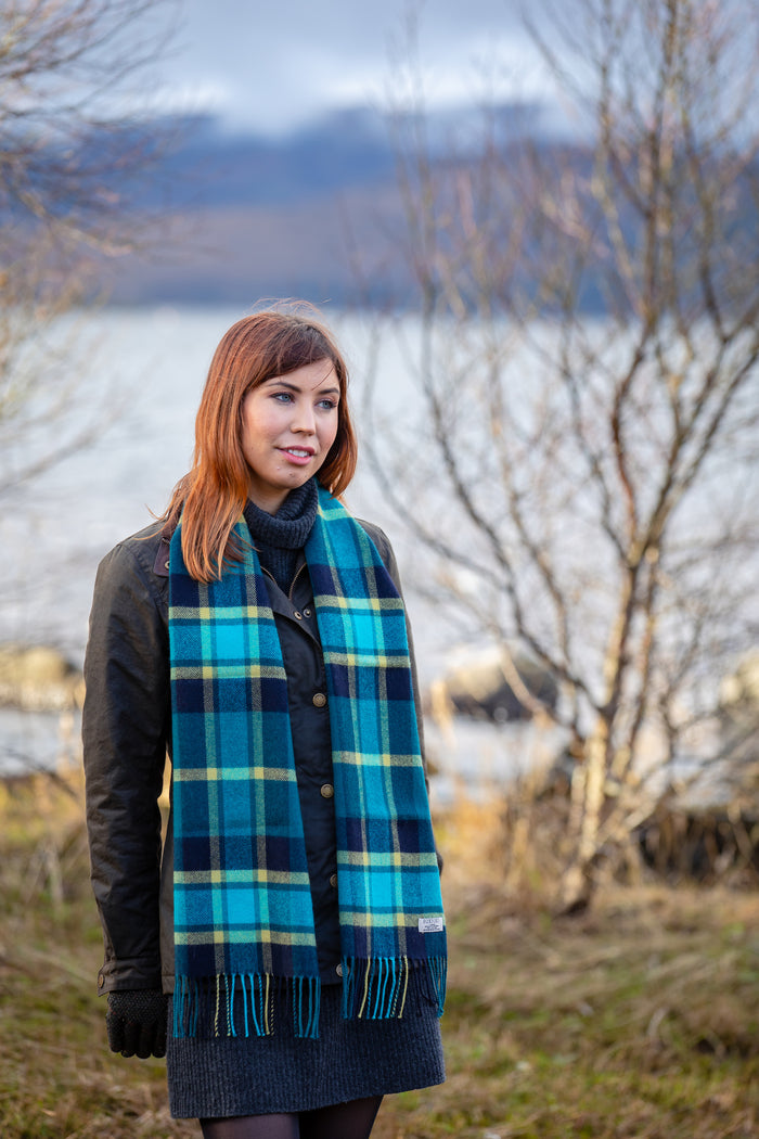 Woman wearing Foxford's Turquoise Mirror Block Check Scarf in the Irish Countryside