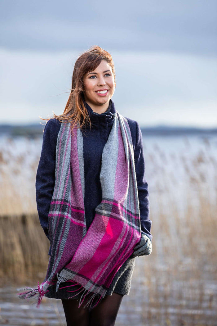 Woman wearing Foxford's Grey and Majenta Check Border Scarf Beside River