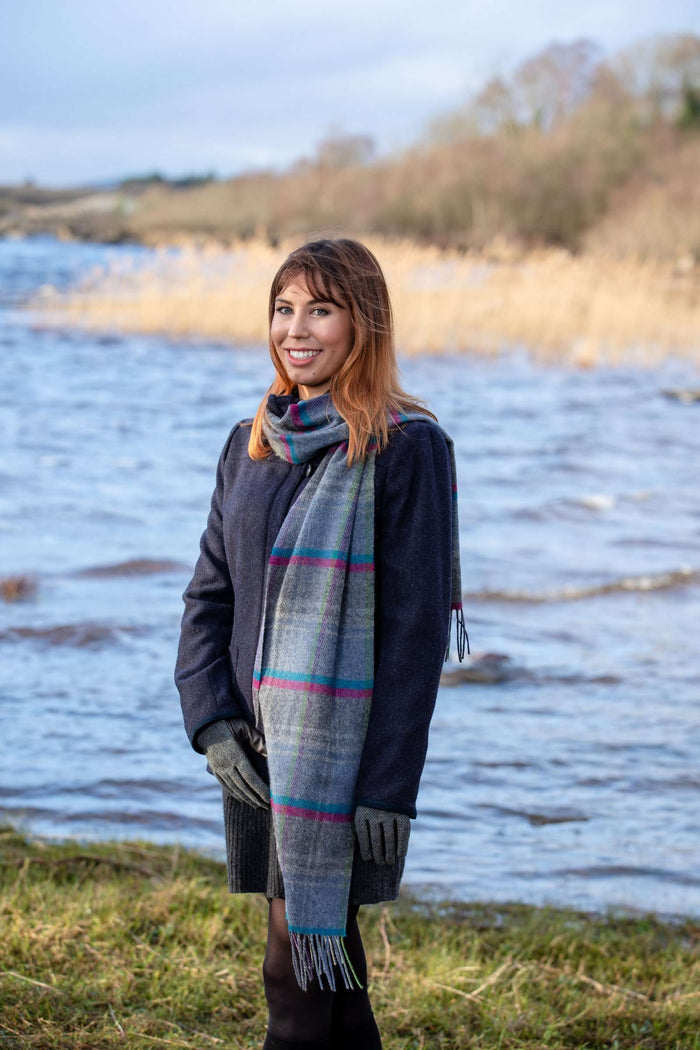 Woman wearing Foxford's Grey Heritage Stripe Scarf Beside River Moy