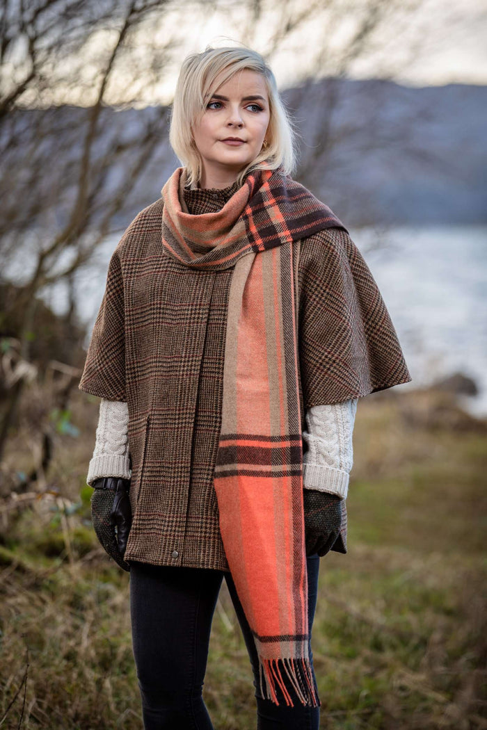 Woman wearing Foxford's Charlotte and Brown Check Border Scarf in Irish Countryside