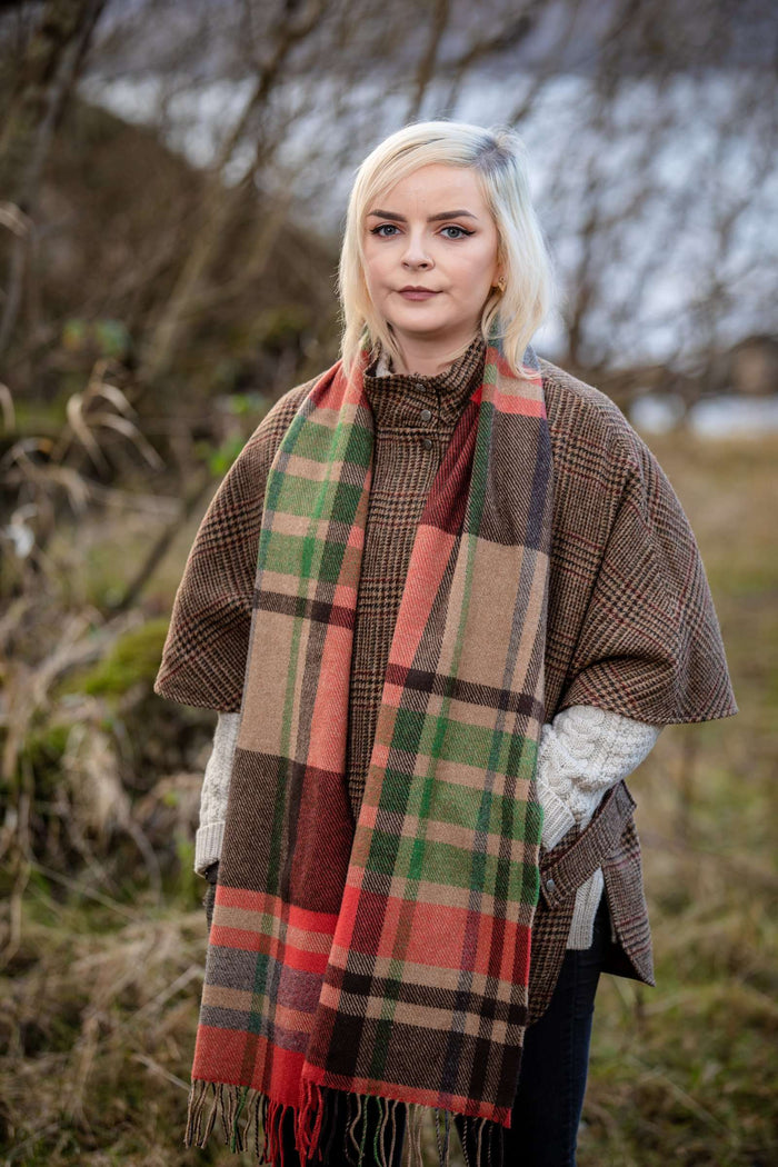 Woman wearing Foxford's Charlotte's Warp Weft Stripe Scarf in Irish Countryside