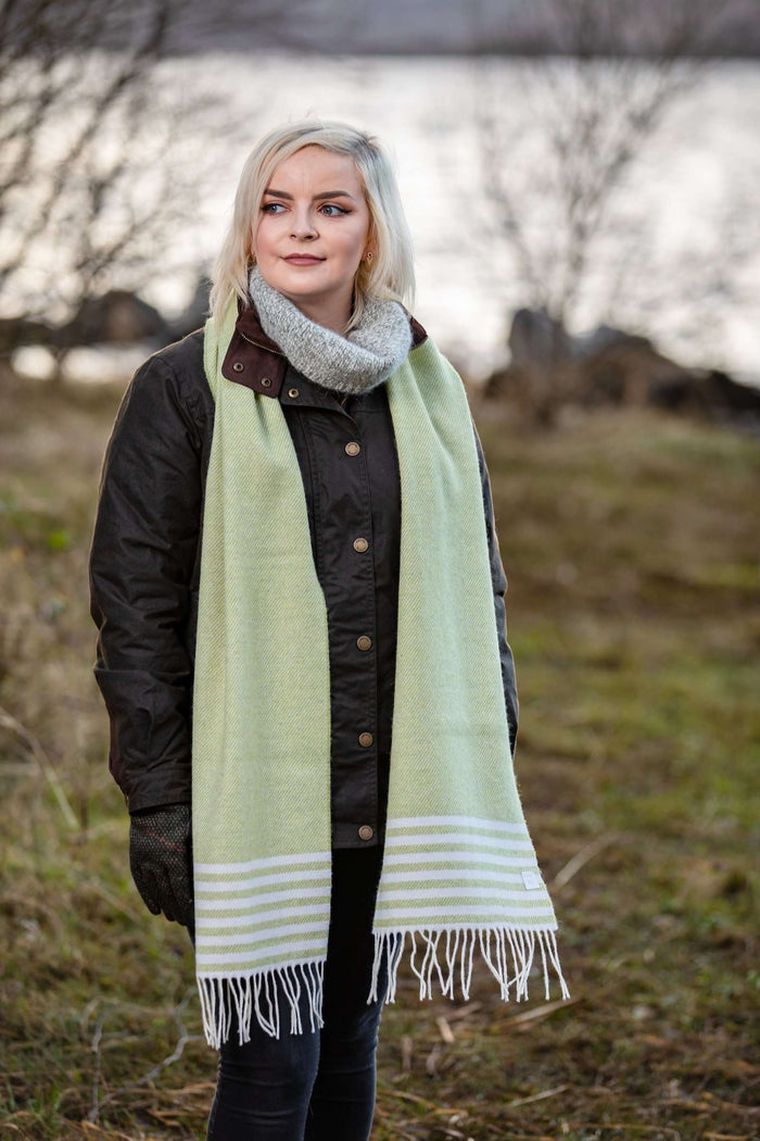 Woman wearing Foxford's Citrus and White Stripe Scarf in Irish Countryside