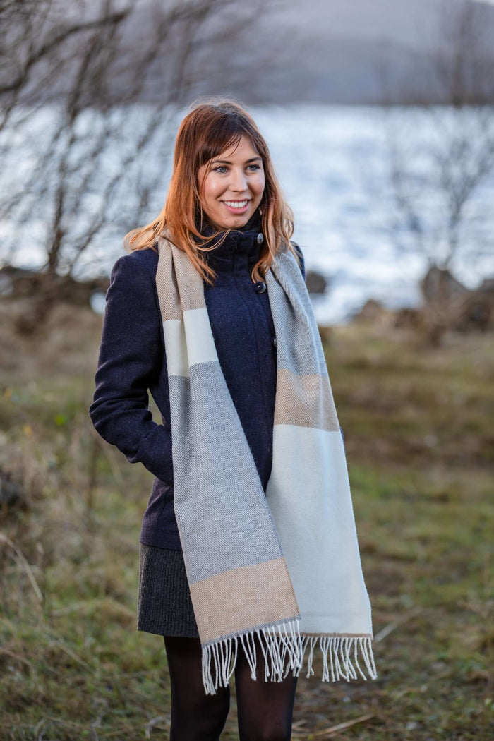 Woman wearing Foxford's White, Uniform and Brown Stripe Scarf in the Irish Countryside