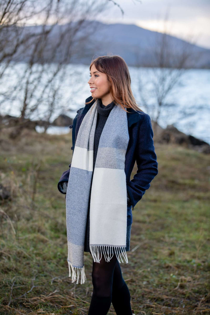 Woman wearing Foxford's White, Uniform and and Jeans Mix Stripe Scarf in Irish Countryside