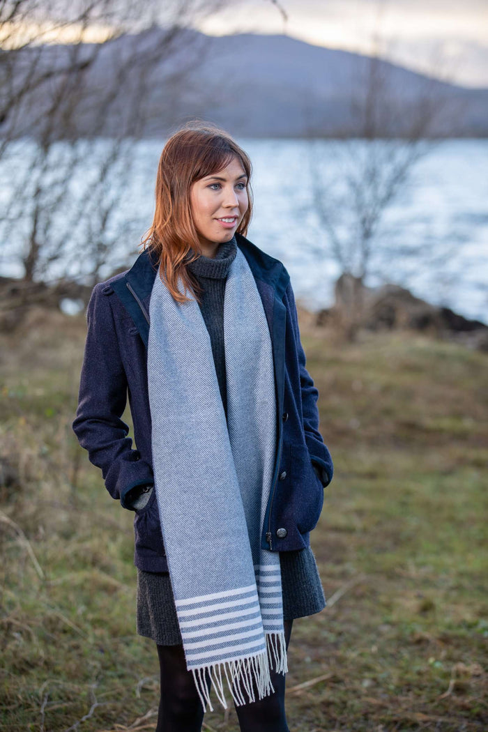Woman wearing Foxford's Jeans Mix and White Stripe Scarf in Irish Countryside