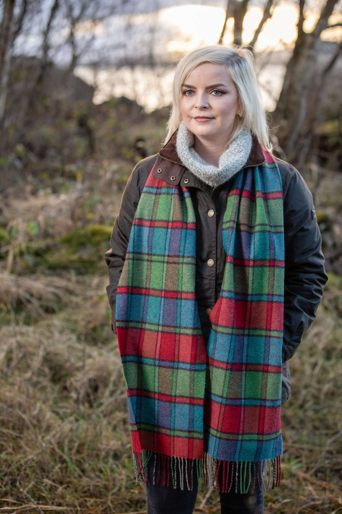 Woman wearing Foxford's Tomato Heritage Block Windowpane Scarf in the Irish Countryside