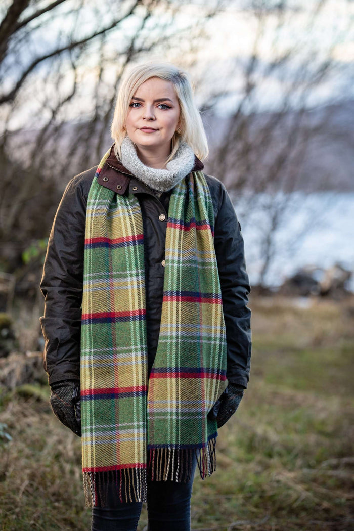 Woman wrapped up in Foxford's Leaf Heritage Stripe Scarf in Irish Countryside