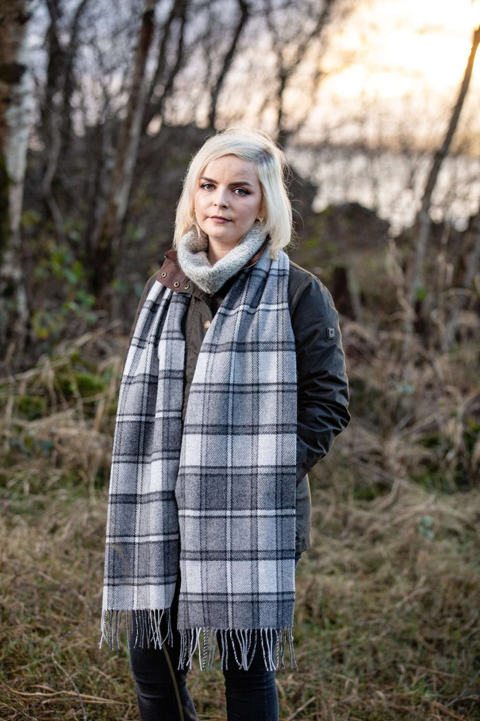 Woman in Irish Countryside wearing Foxford's Classic Heritage Block Windowpane Scarf