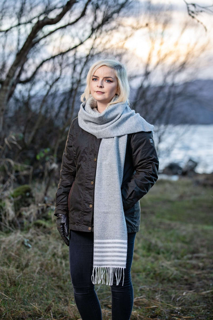 Woman wearing Foxford's Uniform and White Stripe Scarf in Irish Countryside