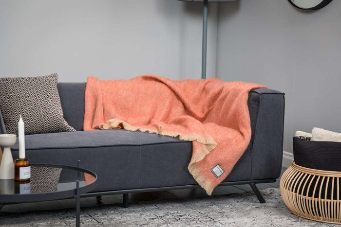 Ethnic Orange Mohair Throw Draped Across Grey Couch
