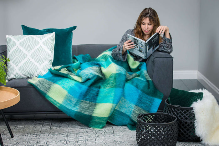 Woman reading wrapped up Green Block Check Mohair Throw