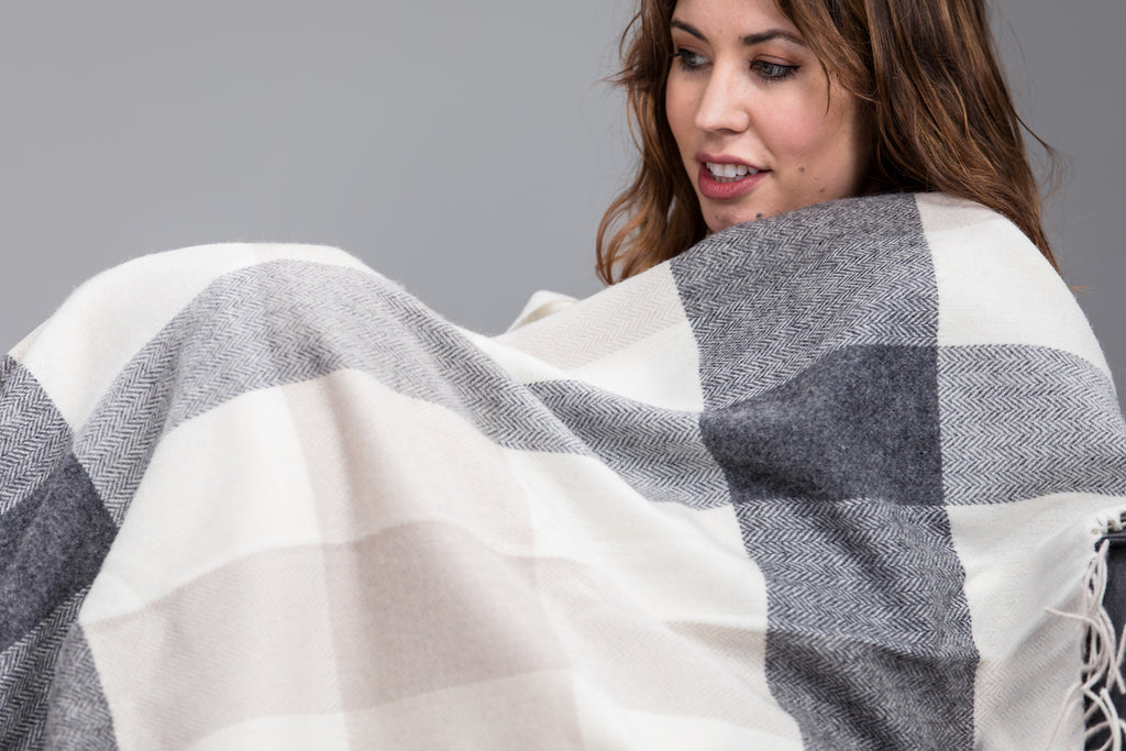 Woman wrapped up in Classic Block Check Lambswool Throw