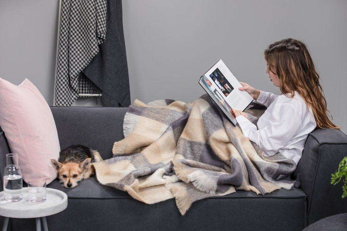 Woman & Dog wrapped up in Classic Bone Block Check Mohair Throw