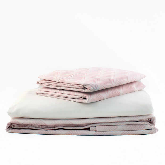Product shot of Foxford's Pink & White Geometric Bed Linen Set. Comprised of Duvet, Fitted Sheet & 2 Pillowcases. 100% Portuguese Cotton. By Foxford.