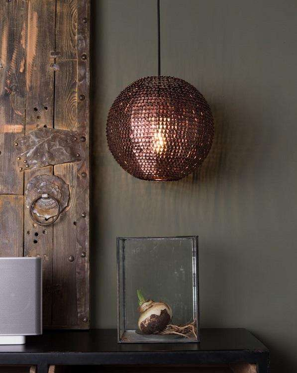 40 Round Copper Pendant Lamp hanging against a grey wall over a black table. Foxford Woollen Mills