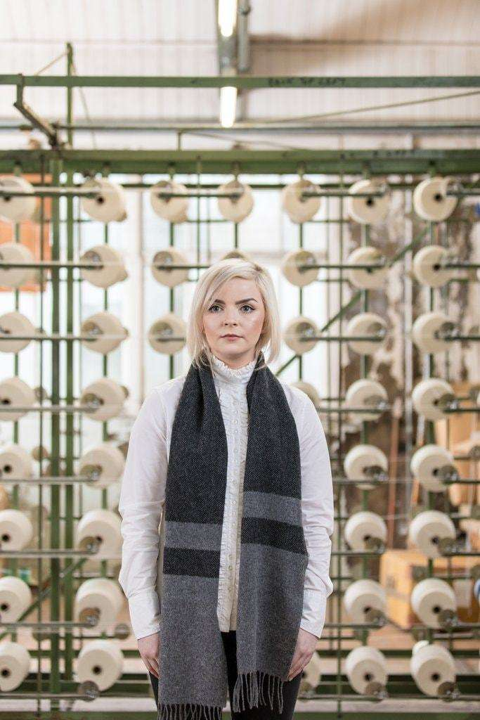 Woman wearing Foxford's Two Tone Grey Black Scarf in Woollen Mill