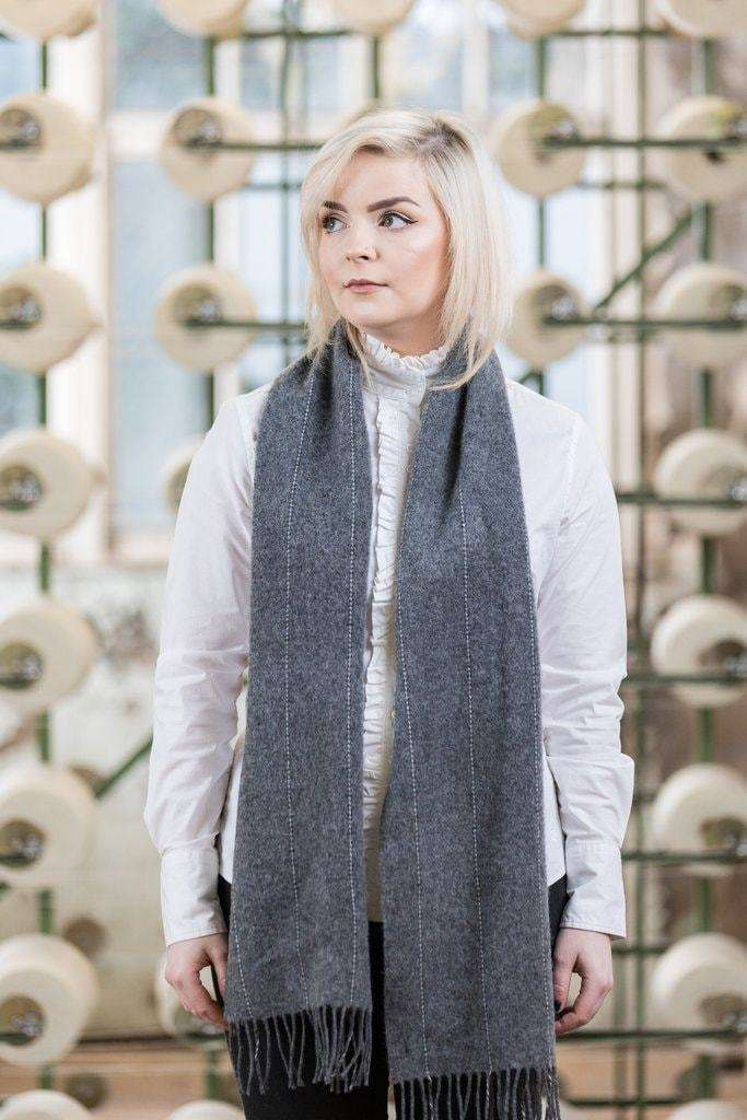 Woman wearing Foxford's Grey Pinstripe Scarf in Woollen Mill