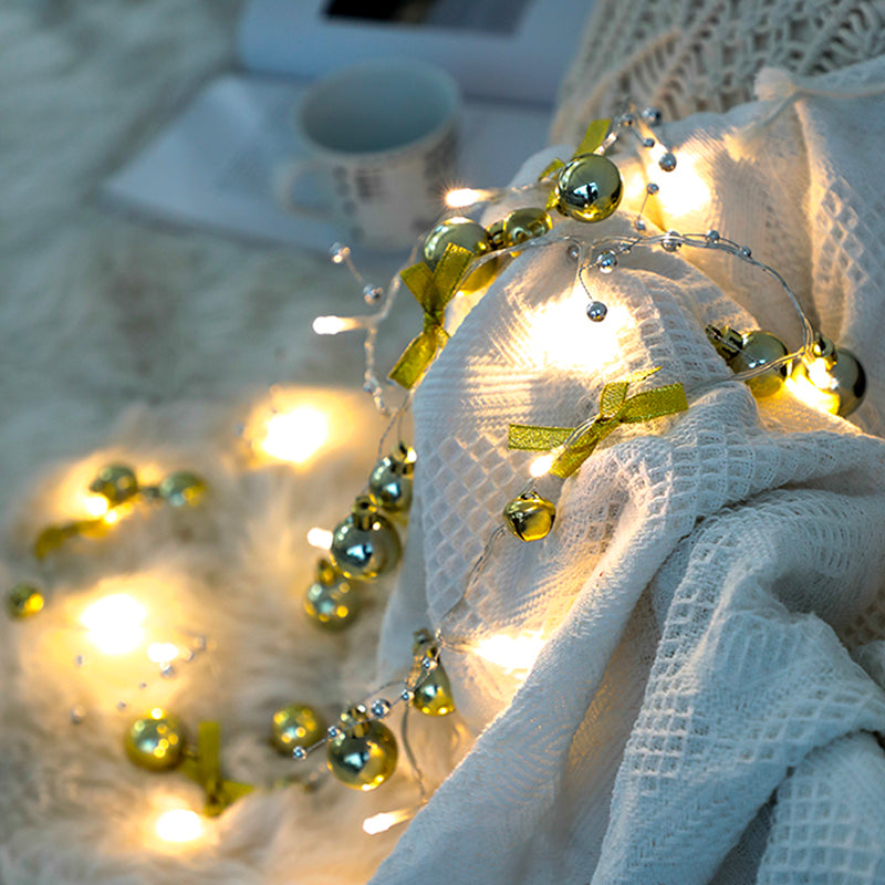 Battery Christmas lights in warm yellow white on string and gold xmas balls
