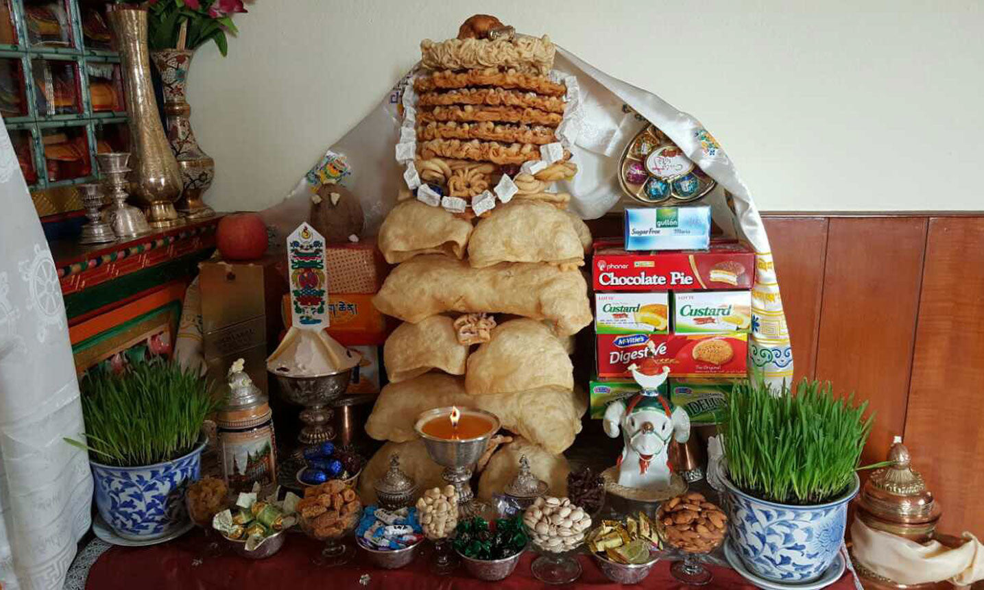 Gyalpo losar sherpa adventure gear a family altar decorated with khapse cakes cookies candies breads and fruits m4hsunfo