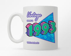 White coffee mug with customization 1990 birth year, with a bright triangle graphic underneath