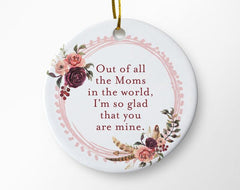 "White ceramic circular ornament with ""Out of all the Moms in the world, I'm so glad that you are mine"" written in raspberry text, surrounded by pink flowers"