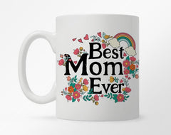 "White coffee mug with ""Best Mom Ever"" in bold black type, surrounded by colorful flowers"