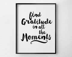 "White art print with ""find gratitude in the moments"" written in black script"