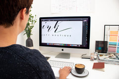 Graphic Designer working at home office desk