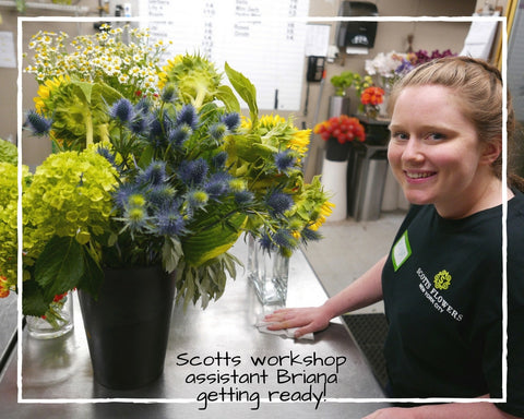 Scotts Flowers NYC Flower Workshop Assistant Wiping Table