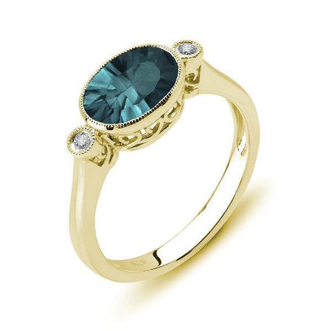 Yellow Gold Blue Topaz and Diamond Ring