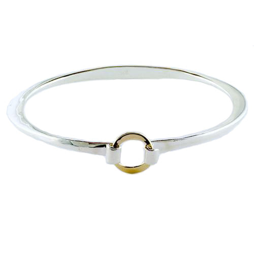 Tom Kruskal A simple Sterling Silver bracelet with a ring of solid 14 Karat Yellow Gold as its buckle.