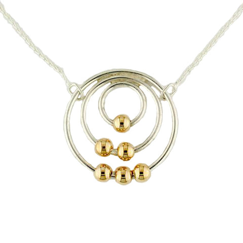 Tom Kruskal Concentric Sterling Silver circles with moving 14 Karat Yellow Gold beads on a silver chain.