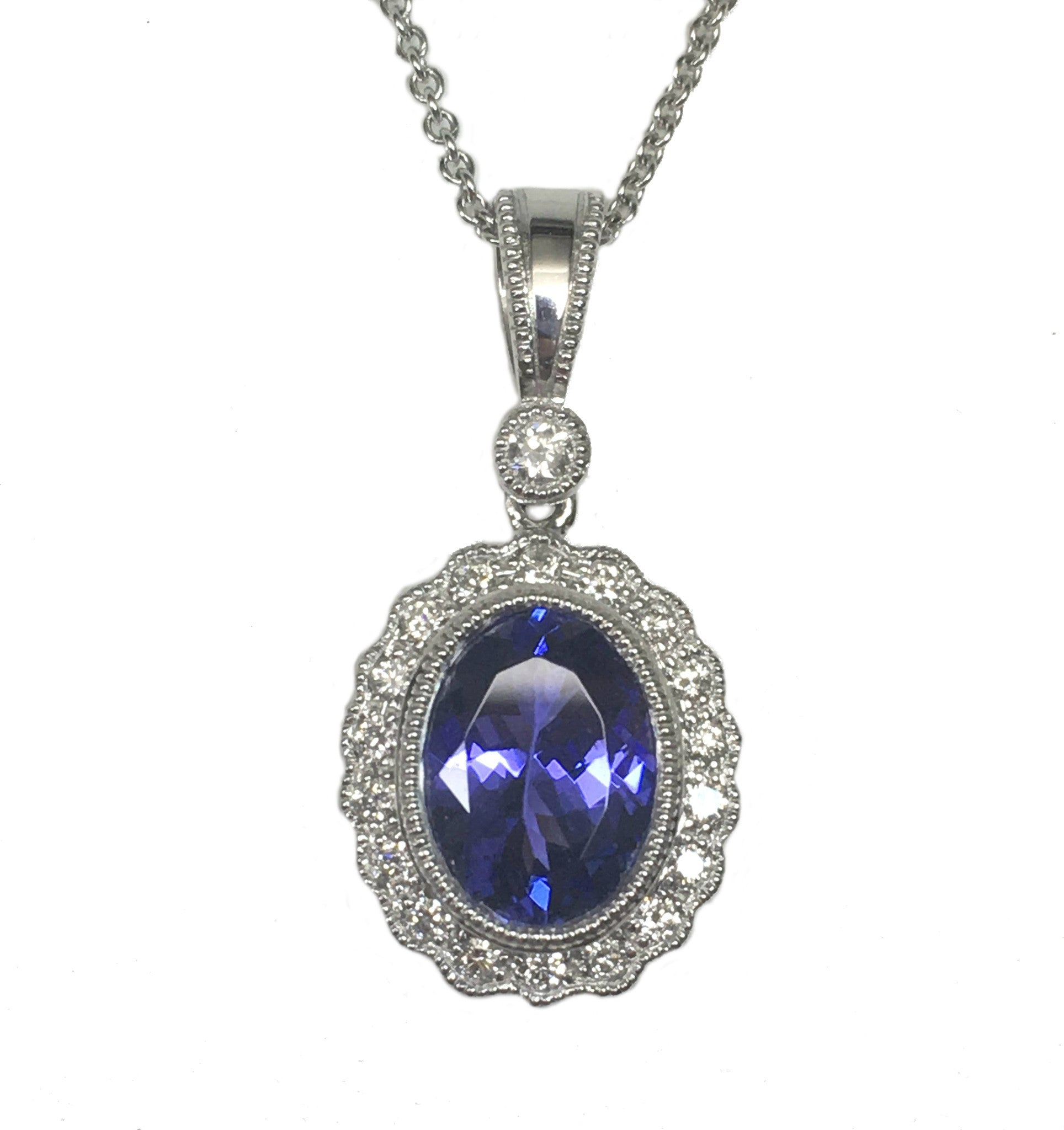shaped tanzanite goldsmiths pendant mccaul and pear commission white gold