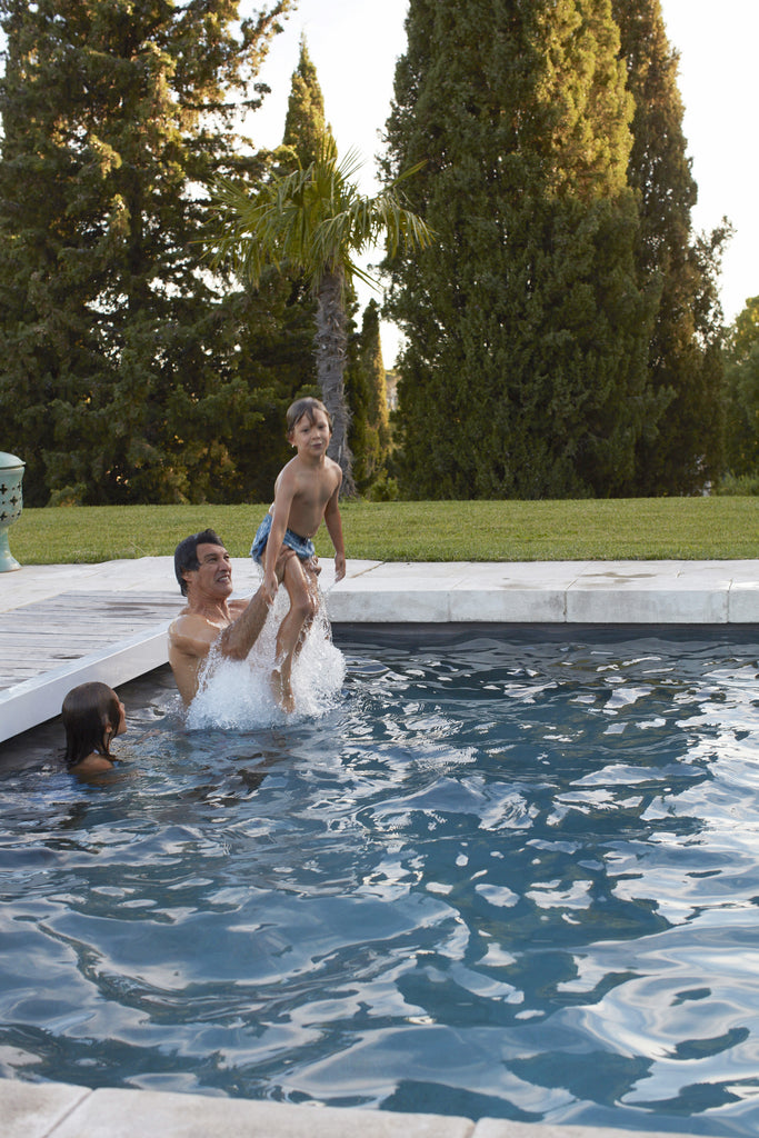 Playing in the pool with Frederic Fekkai and his kids Phillip and Cecilia