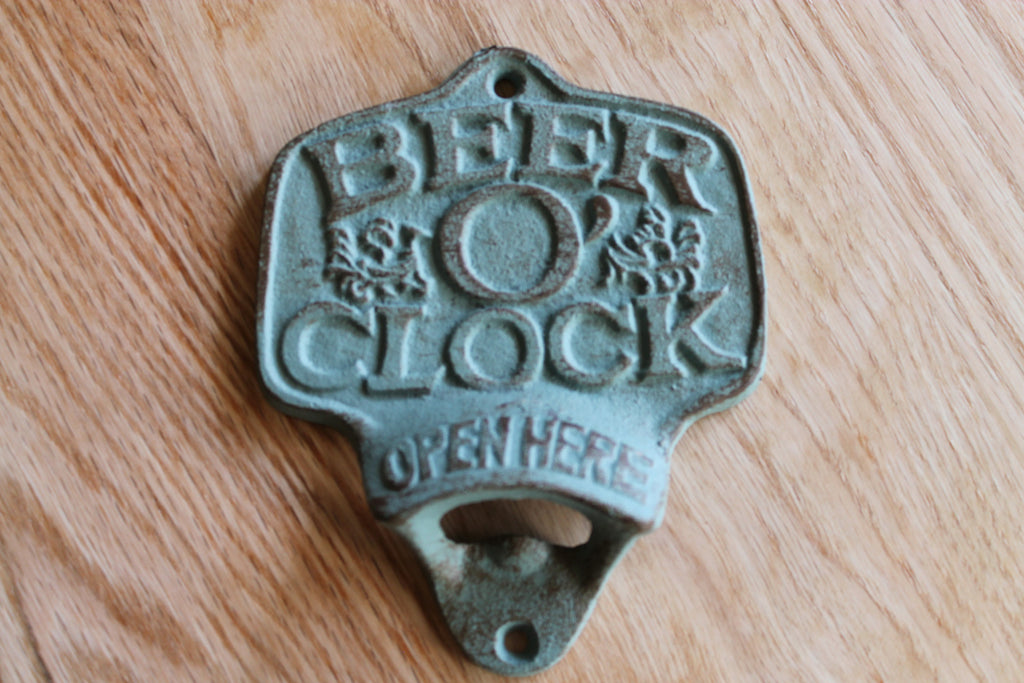 Beer-O-Clock is a wall mounted bottle opener in washed out blue