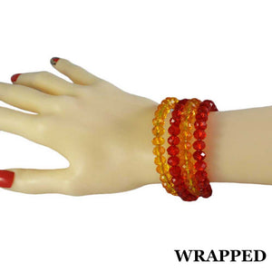 Model with Beaded Red & Yellow Glass Wrap Bracelet with Gold Ball (wrapped) - Lilylin Designs