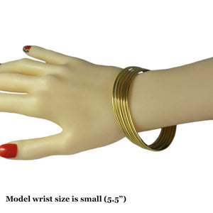 Model with Goldtone Stackable Skinny Bangles-Set of 6-Lilylin Designs